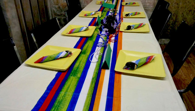 Table with white tablecloth and colorful banner